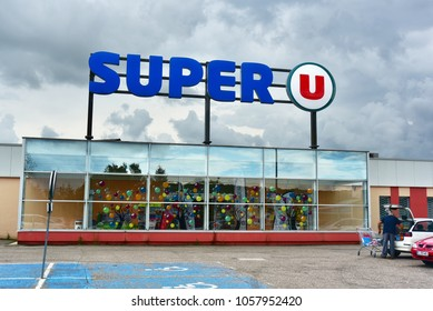 MONTMEDY, FRANCE - AUGUST 16, 2017: Facade of a Super U supermarket, part of Système U a French retailers' cooperative, comprising about eight hundred independent hypermarkets and supermarkets.