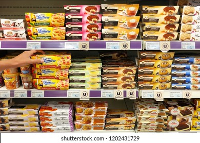 MONTMEDY, FRANCE - AUGUST 16, 2017: Assortment of puddings from a private label brand in a Super U Supermarket.