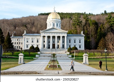 Montpelier, VT, USA - April 21, 2014: Pedestrians stroll in front of the Vermont Statehouse in Montpelier on a warm spring evening.