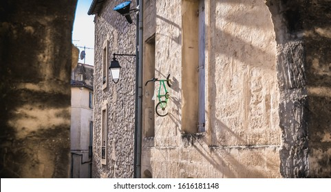 Montpellier, France - January 2, 2019: child's bike hanging on a wall in the historic city center by an anonymous artist with the pseudonym BMX