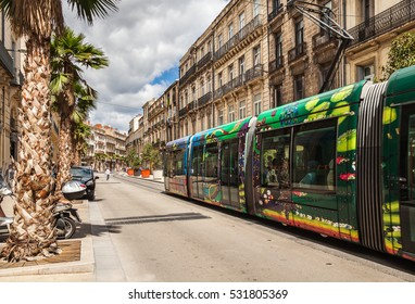 MONTPELLIER, FRANCE - July 8, 2014: Famous colorful tram on in Montpellier, France. In Montpellier four tram lines, which have their own color.