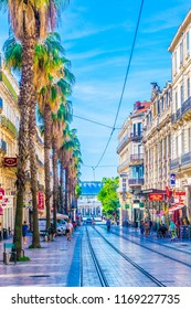 MONTPELLIER, FRANCE, JUNE 26, 2017: People are strolling through a narrow street in the center of Montpellier, France