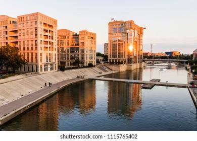 MONTPELLIER, FRANCE - May 17, 2018: Sunset at the river Lez, with the Hotel de Region Occitanie et Languedoc-Roussillon (Occitan Regional Council) in the Quartier Antigone