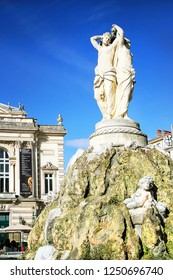 MONTPELLIER, FRANCE – MAY 27, 2014: National Opera theater of Montpellier with three Graces fountain. (Built in the Italian style in 1888 ) on May 27, 2014 in Montpellier, France