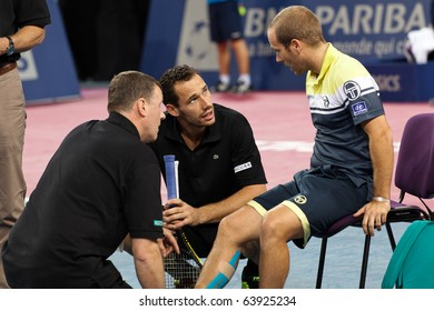 MONTPELLIER - FRANCE - OCTOBER 26 : Olivier Rochus constrained to give up his match against Michael Llodra because of an injury during the Montpellier Tennis Open Sud de France. On October 26, 2010 in Montpellier, France