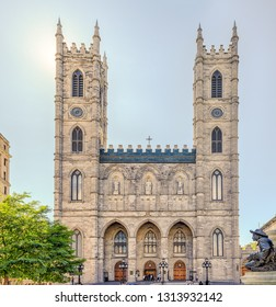 Montreak, Quebec, Canada -  June 25, 2018: Notre-Dame Basilica (French: Basilique Notre-Dame de Montreal) is a basilica in the historic district of Old Montrea, Place d'Armes.