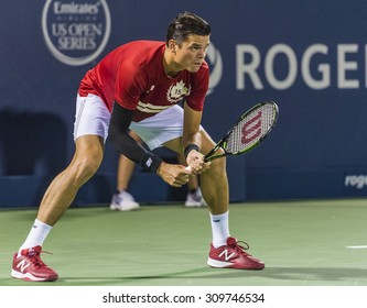 MONTREAL - AUGUST 11: Milos Raonic of Canada during his second round match loss to Ivo Karlovic of Croatia at the 2015 Rogers Cup on August 11, 2015 in Montreal, Canada