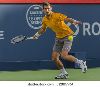 MONTREAL - AUGUST 11: Novak Djokovic of Serbia  during his second round match win over Thomaz Bellucci of Brazil  at the 2015 Rogers Cup on August 11, 2015 in Montreal, Canada