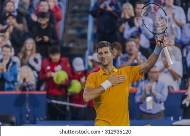 MONTREAL - AUGUST 11: Novak Djokovic of Serbia greats the fans after his second round match win over Thomaz Bellucci of Brazil  at the 2015 Rogers Cup on August 11, 2015 in Montreal, Canada
