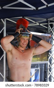 MONTREAL - AUGUST 14: Young man dressed as Roman soldier during reenactment show in Divers/cite festival on August 14, 2010 in Montreal, Canada For the promotion of safe sex.