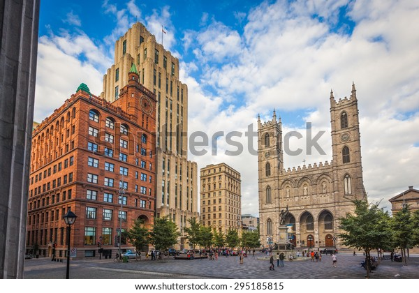 MONTREAL, AUGUST 18:  View of Place d'Armes with the Paul de Chomedey monument, the Notre-Dame basilica and the New York Life and Aldred buildings on August 18, 2014 in Montreal, Quebec.