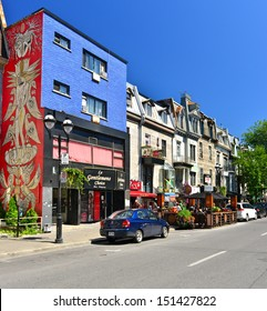 MONTREAL - AUGUST 24 : Saint-Denis Street is a major north-south thoroughfare in Montreal on August 24, 2013. It passes through the boroughs of Ville-Marie, Le Plateau-Mont-Royal, Rosemont and others.