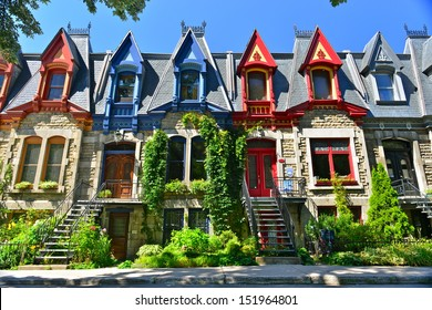 MONTREAL - AUGUST 24: Victorian Houses in Square Saint Louis on August 24th,2013. The square was created in 1876, and named for two businessmen, brothers Emmanuel and Jean-Baptiste Saint-Louis.