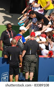 MONTREAL - AUGUST 5:Roger Federerl with fans of Montreal Rogers Cup on August 5, 2009 in Montreal, Canada.Roger Federer is a Swiss professional tennis player who held 1 position for a record 237 weeks