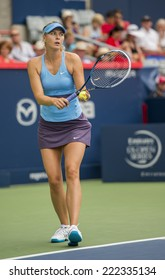 MONTREAL - AUGUST 7: Maria Sharapova of Russia in her Third round loss to Carla Suarez Navarro of Spain at the 2014 Rogers Cup on August 7, 2014 in Montreal, Canada