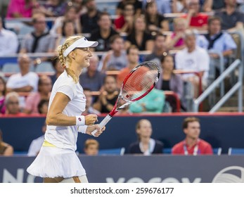 MONTREAL - AUGUST 8: Ekaterina Makarova of Russia in her quarter  match win over Coco Vandeweghe of USA at the 2014 Rogers Cup on August 8, 2014 in Montreal, Canada