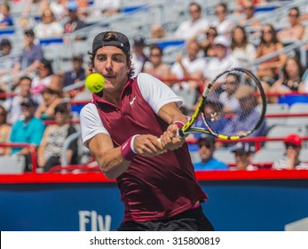 MONTREAL - AUGUST 8: Thanasi Kokkinakis of Australia against Pierre-Hugues Herbert of France during his qualifying match at the 2015 Rogers Cup on August 8, 2015 in Montreal, Canada