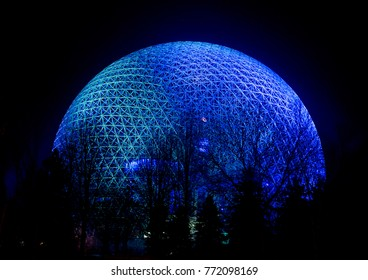 The Montreal Biosphere is shown at night