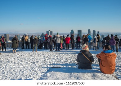 Montreal, CA - 1 January 2017: Tourists looking at Montreal Skyline from the Kondiaronk Belvedere on Mount Royal