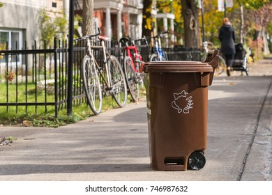 Montreal, CA - 1 November 2017: brown compost container on the street