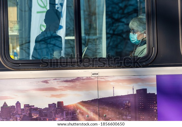 Montreal, CA - 10 November 2020: STM Bus passenger with face mask during Covid 19 pandemic