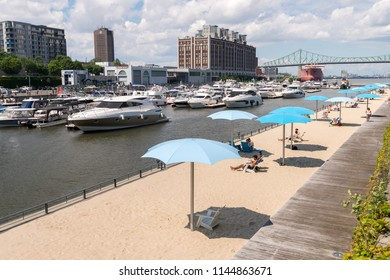 Montreal, CA - 12 July 2017: Clock Tower Beach in the Old Port of Montreal