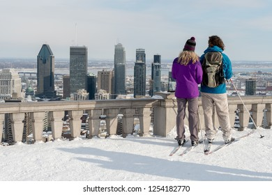 Montreal, CA - 14 February 2017: Couple looking at Montreal Skyline