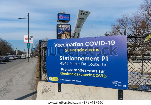 Montreal, CA - 16 March 2021 : Covid-19 vaccination centre sign in front of Olympic Stadium