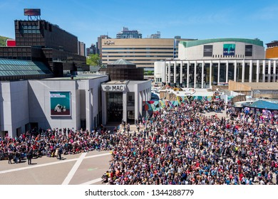 Montreal, CA - 20 May 2017: Crowd on Place des Arts attenting a street performance
