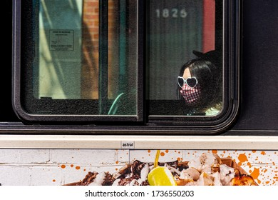 Montreal, CA - 20 May 2020: STM Bus passenger with face mask during Covid 19 pandemic