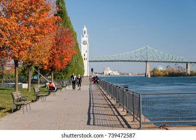 Montreal, CA - 21 October 2017: Montreal Clock Tower and Jacques Cartier Bridge with autumn colours