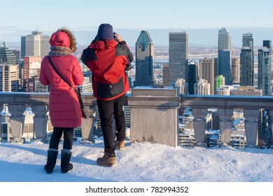 Montreal, CA - 26 December 2017: Tourists looking at Montreal Skyline from Kondiaronk belvedere in winter.