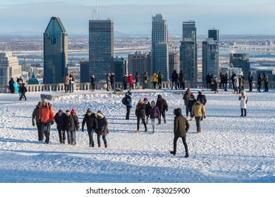 Montreal, CA - 26 December 2017: People at the Kondiaronk Belvedere located at the summit of Mont Royal. The belvedere is a famous lookout over Montreal Skyline.