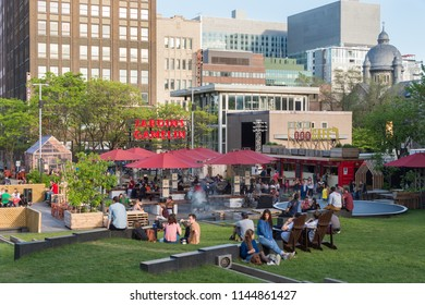 Montreal, CA - 27 May 2017: People relaxing in the Jardins Gamelin in the Emilie Gamelin Square