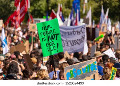 """Montreal, CA - 27 September 2019: """"Our Future is Not For Sale"""" sign at the Montreal Climate March."""