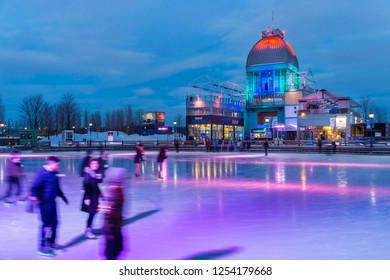 Montreal, CA - 3 February 2017: People skating on Pavillon Bonsecours ice skating rink, at the Old Port of Montreal.