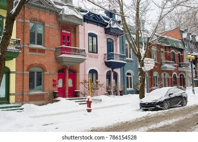 Montreal, CA - 3 January 2018: Row houses with colorful facades in the Plateau neighborhood in Montreal, in winter.