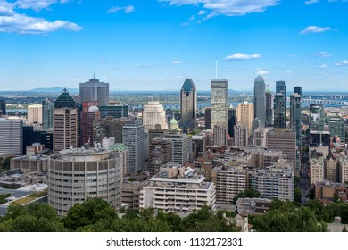 Montreal, CA - 7 July 2018: Montreal skyline from Kondiaronk Belvedere located at the top of the Mont-Royal mountain.