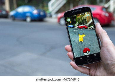 Montreal, CA - August 11, 2016: Closeup of a man playing Pokemon Go on a smart phone. Pokemon Go is a virtual reality game released in July 2016.