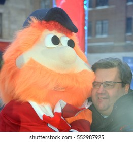 MONTREAL CANADA 01 06 17: Mascot Youppi! and Denis Coderre mayor of Montreal at the kick off of 375 anniversary of Montreal city celebrations in 2017 in collaboration with public and private partners.