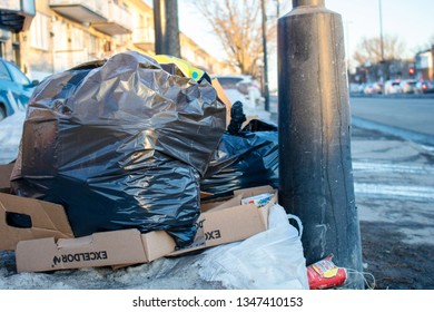 MONTREAL, Canada – 03/12/2019: outdoor trash and garbages on the sidestreet.