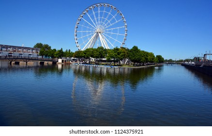 MONTREAL CANADA 06 20 18: La Grande Roue de Montreal the tallest Ferris wheel in Canada allows you to see the city and its surroundings from 60 metres in the air, the equivalent of 20-storey building