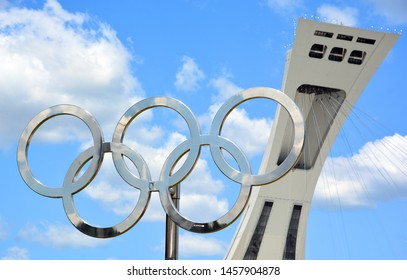 MONTREAL CANADA 07 12 2019: Montreal Olympic tower and olympic rings. Olympic flame is a symbol of the Olympic Games Commemorating the theft of fire from the Greek god Zeus by Prometheus