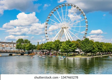 MONTREAL, Canada – 07/29/2018: Beautiful view of the Big Ferry Wheel at the Old Port of Montreal. One of the greatest touristic attraction in Montreal.