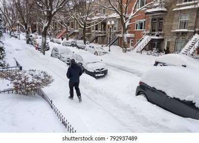 Montreal, CANADA - 13 January 2018: cars are covered with snow during snowstorm in the Plateau neighborhood.
