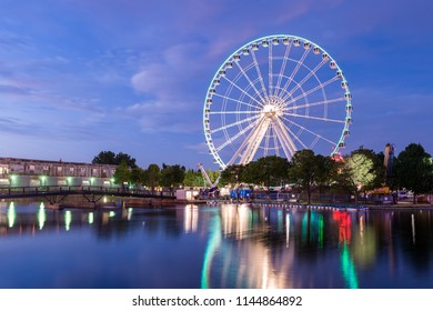 Montreal, Canada - 13 July 2017: The Montreal Observation Wheel (Grande Roue de Montreal) in the Old Port of Montreal at night