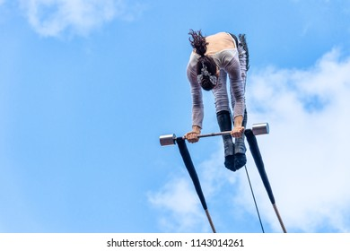 Montreal, Canada - 14 July 2018: Trapeze artist performing during Montreal Completement Cirque festival