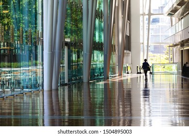 Montreal, Canada - 14th September 2017: The Palais des Congres, or Palace of Congress, in downtown Montreal, Canada. A womon is walking through the vast hallway of this Internationl Conference Centre.