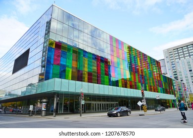 MONTREAL, CANADA -17 OCT 2018- View of colorful glass panes on the Palais des Congres convention and exhibition center in Montreal, located on Place Jean-Paul Riopelle next to Chinatown.