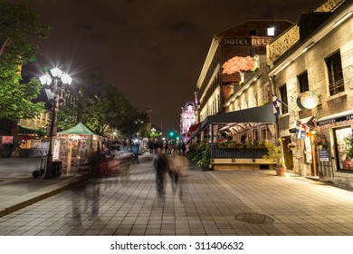 MONTREAL, CANADA - 17TH MAY 2015: A view of buildings in Old Town Montreal at night showing the blur of people.